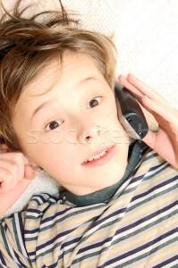 1530292_stock-photo-teen-boy-talking-on-cell-phone